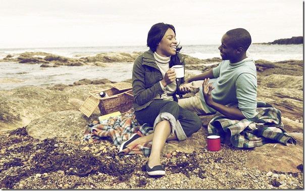 Couple having picnic on beach - Image Source: Modified by PSD tuts for tutorial -Original Source: PhotoDune
